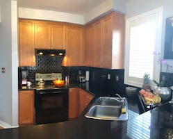 Full kitchen with granite countertops and appliance