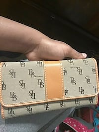 brown and white Dooney & Bourke leather wallet Lubbock, 79412