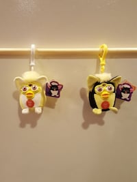 two yellow-white-black Furby plush toys