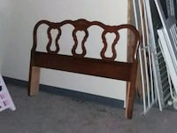 brown wooden bed head board Pell City