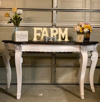 White wooden table with black top Rancho Cucamonga, 91739