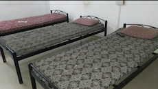 grey and white floral bedspread