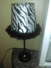 black table lamp with Zebra pattern shade