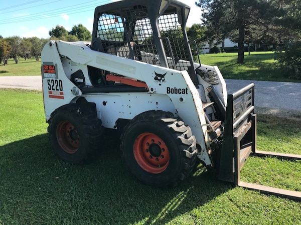 White and black bobcat skid loader
