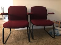 Two red padded black metal armchairs Overland Park, 66210