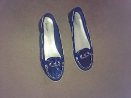 Women's pair of boat shoes size 10. Blue sparkle color. Worn once