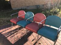 two blue and two brown leather seat armchairs with stainless steel bases Jefferson City, 65109