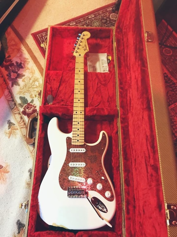 Fender Stratocaster Mexican made. Upgraded pick guard and locking tuners