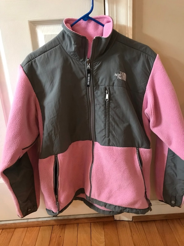 black and pink The North Face zip-up jacket