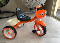 Brand new bike but used one day it's has lights on wheels and music on seat located hoppers crossing