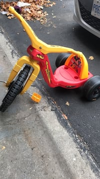 toddler's red and yellow Big Wheel trike