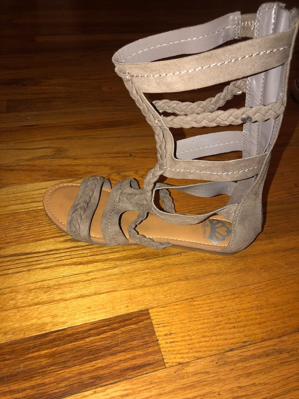 pair of gray leather open toe ankle strap heels ad611c49-1d12-4611-a25a-5ea8a756b648