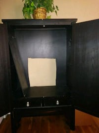 black wooden TV hutch with flat screen television Kansas City, 64109