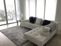 tufted white sectional sofa and throw pillows Miami, 33130