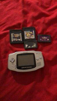White nintendo game boy advance with game cartridges Gaithersburg, 20877