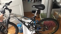 black and blue Mongoose full-suspension mountain bike Wrightsville Beach, 28480