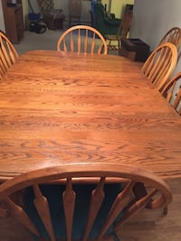 Dining room table with chairs and hutch