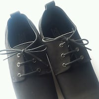 Men's size 42 (8.5 to 9.5) brand new black leather dress shoes.