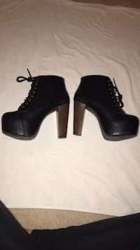 pair of black leather chunky-heeled platform booties