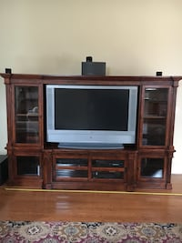 white and brown wooden TV hutch with flat screen television