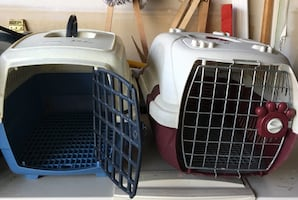 Two white and black pet carriers