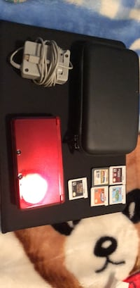 Red Nintendo 3ds comes with charger and games New York, 10304