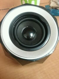 round black and gray subwoofer