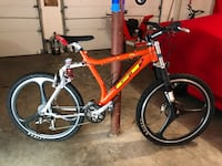 Red and white full-suspension mountain bike