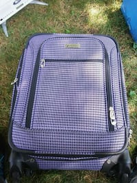 Purple & black rolling luggage bag. South Bend, 46635