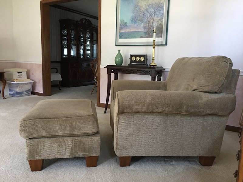 Tan Armchair/couch with ottoman 1f266f74-551c-4de0-a36f-919e4c265dee