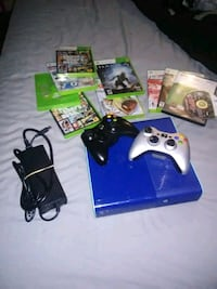 Xbox 360 console with controllers and game cases Knoxville, 37917