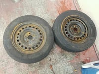 two black bullet hole car wheels with tires 925 mi