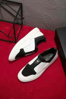 white-and-black Emporio Armani slip-on shoes