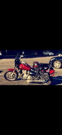 red and black touring motorcycle Bethpage, 11714