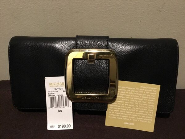 dc650612e94 Begagnad authentic rare Michael Kors SUTTON GENUINE LEATHER BLACK CLUTCH.  New