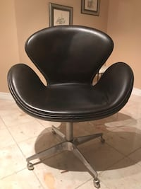 black leather padded rolling armchair 558 km