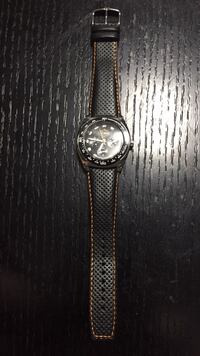 round silver chronograph watch with black leather strap London, N5X