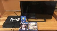 black Sony PS4 game console with game cases El Paso, 79916