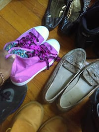 three pairs of assorted shoes St. Louis, 63138