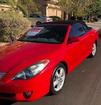 red and black convertible coupe 2057 mi