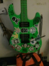 green and black electric guitar Parsippany-Troy Hills, 07054