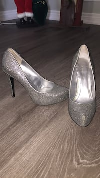 Pair of silver-glittered heeled pumps
