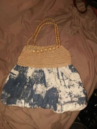 women's black, brown, and white tote bag