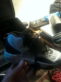 pair of black-and-blue Nike basketball shoes
