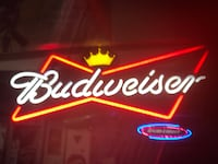 red and white Budweiser neon signage