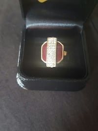 gold and red diamond encrusted pin Vaughan