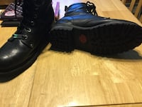 Pair of black leather boots Leicester, 01524