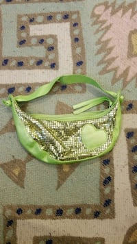 women's green and silver sequinned hand bag
