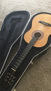 Brown and black acoustic guitar Little Canada, 55117