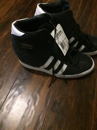 Pair of black-and-white adidas high-top sneakers Burlington, L7M 1K1